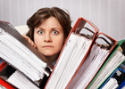 Photo: Accountant swamped with financial documents