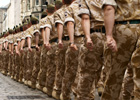 Photo: British Army in desert uniform marching along a street