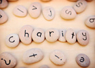 Photo: Pebbles spelling out the word 'charity'