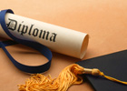 Photo: Diploma and graduate cap