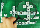 Photo: Scrabble tiles with the word 'job' magnified