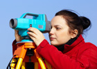 Photo: Female land surveyor using a digital level