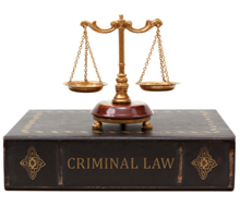 Photo: A set of scales on top of a book on criminal law