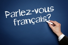 Photo: 'Parlez-vous francais?' written on a chalkboard